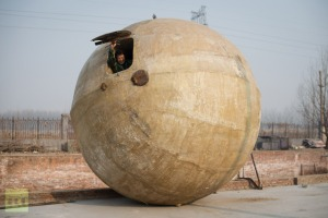 Farmer Liu Qiyuan inside one of seven survival pods, in a yard at his home in the village of Qiantun, Hebei province, south of Beijing. December 11, 2012 (AFP Photo / Ed Jones)